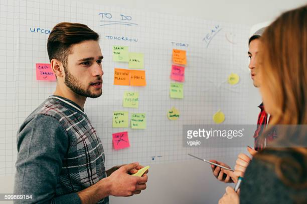start-up team discussion. - action plan stock photos and pictures