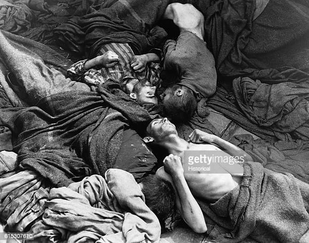 Starved bodies of prisoners who were transported to Dachau from another concentration camp lie grotesquely as they died enroute This is contents of...