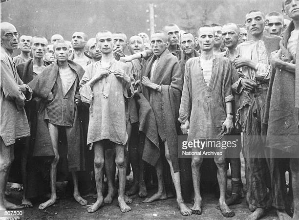 "Starved prisoners, nearly dead from hunger, pose in concentration camp May 7, 1945 in Ebensee, Austria. The camp was reputedly used for ""scientific""..."