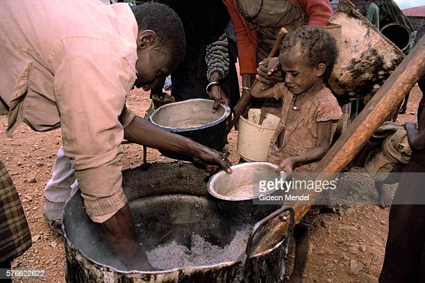 Starving Child Being Fed