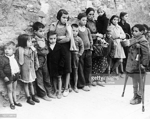 Starving children queue for food in Madrid, Spanish Civil War. Starving children queue for food in Madrid, Spanish Civil War. Photograph by Edward G...