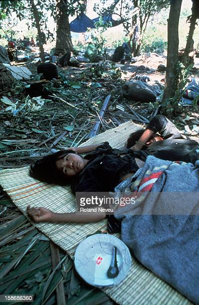 Starving Khmer Rouge refugees lie down exhausted in woods along the Thai/Cambodian border They have just received their first relief from...