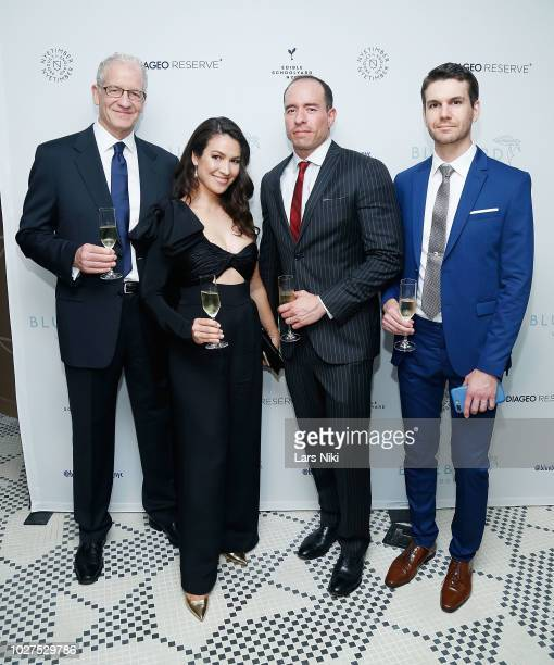 Stas Ginzburg, Lisa Houlbert, Erik Haines and James Yedloutschnig attend the Bluebird London New York City launch party at Bluebird London on...