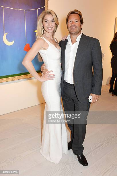 """Stasha Palos and brother Brett Palos attend a private view of """"And The Stars Shine Down"""" by Stasha Palos at the Saatchi Gallery on December 2, 2014..."""