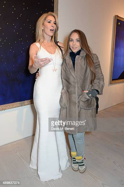 """Stasha Palos and Chloe Green attend a private view of """"And The Stars Shine Down"""" by Stasha Palos at the Saatchi Gallery on December 2, 2014 in..."""