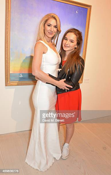 """Stasha Palos and daugher Lily attend a private view of """"And The Stars Shine Down"""" by Stasha Palos at the Saatchi Gallery on December 2, 2014 in..."""
