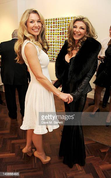 Stasha Palos and Lisa Tchenguiz attend a private viewing of 'Colour: An Exhibition By Stasha', featuring works by Stasha Palos, at The Gallery In...