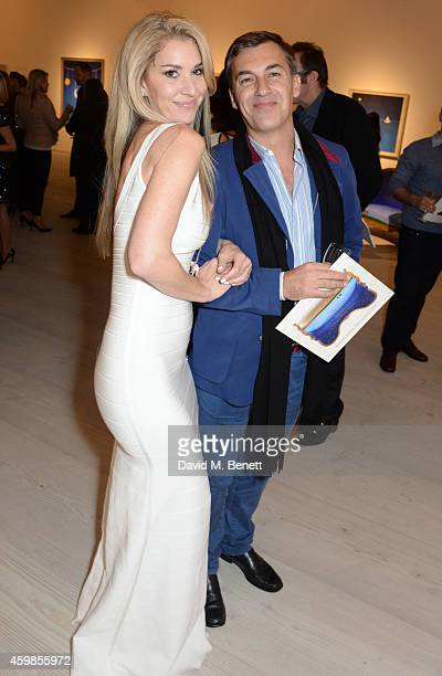 """Stasha Palos and Robin Cook attend a private view of """"And The Stars Shine Down"""" by Stasha Palos at the Saatchi Gallery on December 2, 2014 in London,..."""