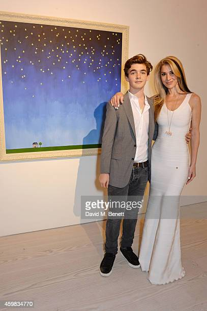 """Stasha Palos and son Jordan attends a private view of """"And The Stars Shine Down"""" by Stasha Palos at the Saatchi Gallery on December 2, 2014 in..."""