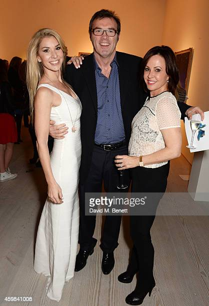 """Stasha Palos, Andrew Morton and wife Carolyn attend a private view of """"And The Stars Shine Down"""" by Stasha Palos at the Saatchi Gallery on December..."""