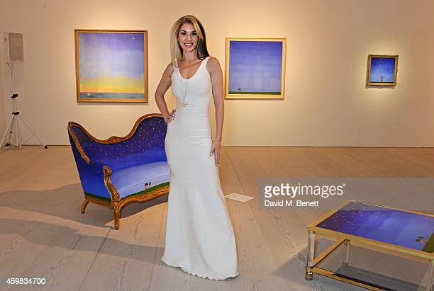 """Stasha Palos attends a private view of her exhibition """"And The Stars Shine Down"""" at the Saatchi Gallery on December 2, 2014 in London, England."""