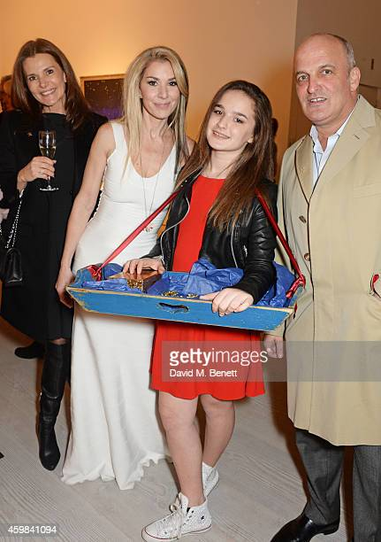 """Stasha Palos, daughter Lily and Scott Spiro attend a private view of """"And The Stars Shine Down"""" by Stasha Palos at the Saatchi Gallery on December 2,..."""