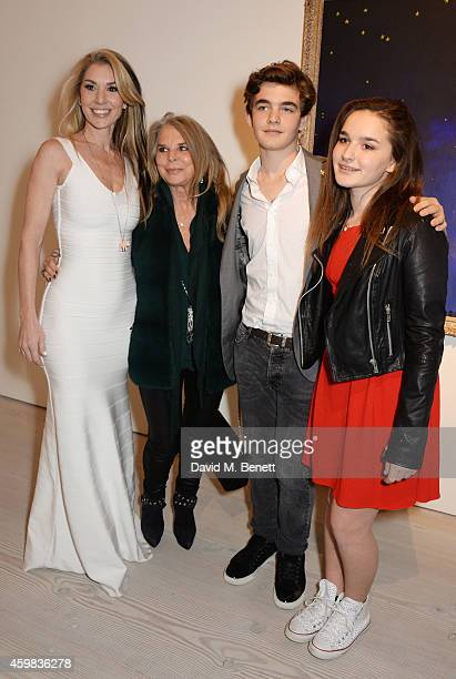 """Stasha Palos poses with mother Lady Tina Green and children Jordan and Lily at a private view of """"And The Stars Shine Down"""" by Stasha Palos at the..."""