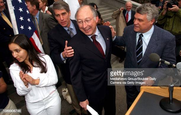 State Attorney General Ken Salazar gets pats on the back from Congressman Mark Udall and Rutt Bridges while his daughter Andrea Salazar claps after...