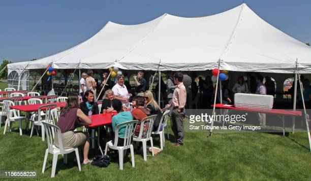 State Bank Trust employees gathered under a tent for lunch during the employee appreciation day cookout at the bank building in Golden Valley on...