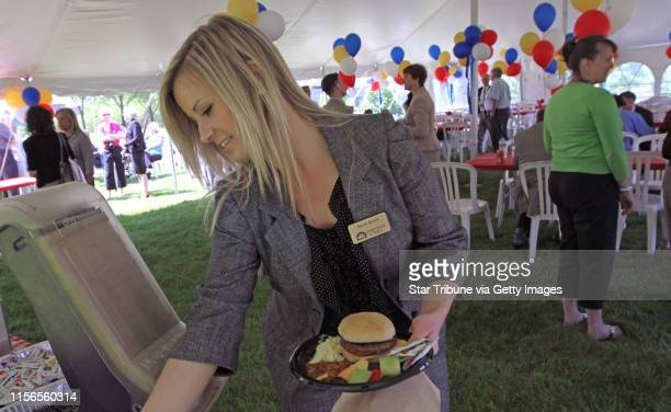 State Bank Trust Personal Banker Anna Abeld got lunch during the employee appreciation day cookout at the bank building lawn in Golden Valley on...