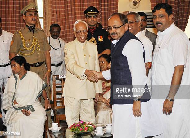 State BJP leaders Siddharth Nath Singh and Rahul Sinha greet new Governor of West Bengal Keshari Nath Tripathi during tea party after his swearingin...