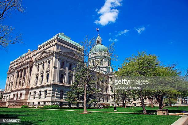 State capitol building in downtown Indianapolis Indiana on a sunny spring morning Indianapolis is the capital city of Indiana and is located in the...