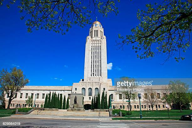 State capitol building in Lincoln Nebraska on a sunny spring day and emphasizing the building's tall central tower and dome Lincoln the capital city...
