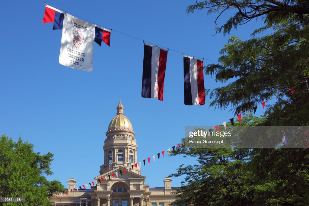 State Capitol of Wyoming and colorful flags : Photo