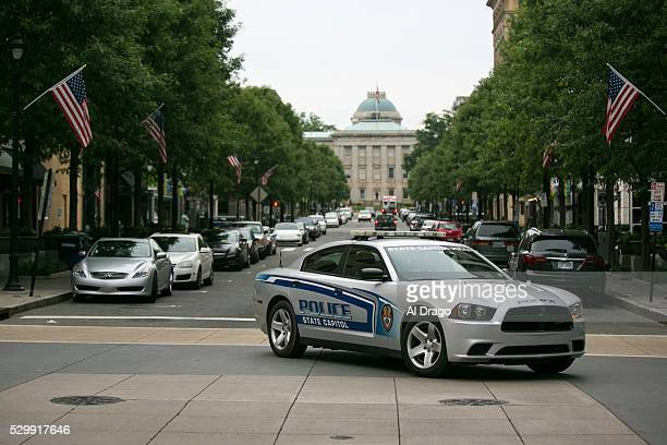 State Capitol Police car drives near the North Carolina State Capitol on Fayetteville Street in Raleigh NC on Monday May 9 2016 Gov Pat McCrory and...