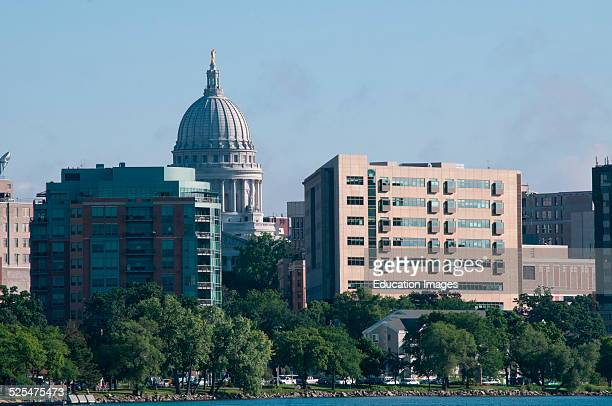State capitol rises behind lake shore buildings Madison Wisconsin