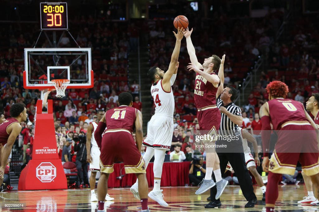 NC State center Omer Yurtseven (14) and Boston College forward Nik Popovic (21) fight for the tip off during the game between the Boston College Eagles and the NC State Wolfpack at PNC Arena on February 20, 2018 in Raleigh, NC.