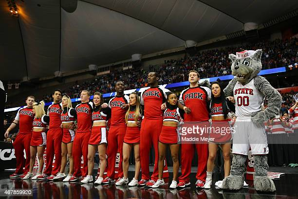 State cheerleaders sing their Alma Mater following the East Regional Semifinal of the 2015 NCAA Men's Basketball Tournament at the Carrier Dome on...
