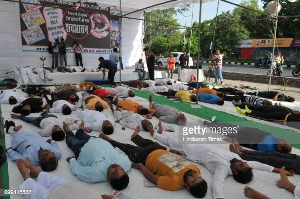 MP state congress president Arun Yadav along with party workers performing ' Shava asana' to protest against chief minister Shivraj Singh Chouhan who...