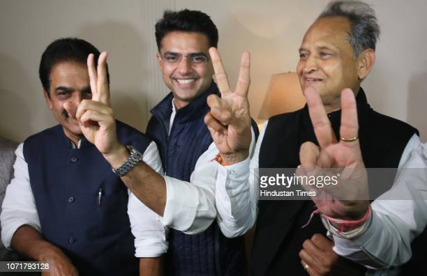State Congress President Sachin Pilot and former CM Ashok Gehlot flash victory sign along with KC Venugopal during a press conference, on December...