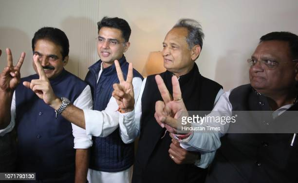 State Congress President Sachin Pilot and Former CM Ashok Gehlot flash victory sign along with party leaders Avinash Pandey and KC Venugopal during a...