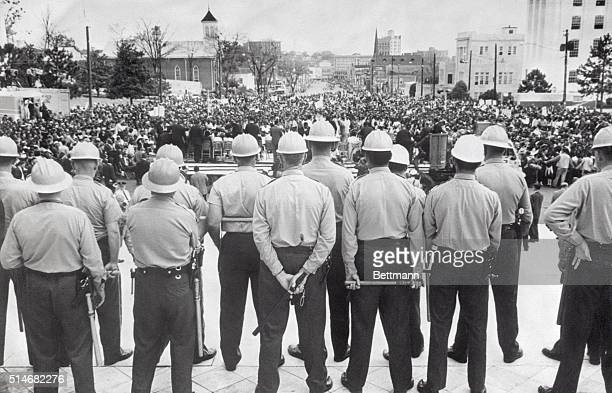 State conservation department agents with nightsticks watch as civil rights marchers arrive at the Alabama State Capitol in Montgomery, Alabama after...