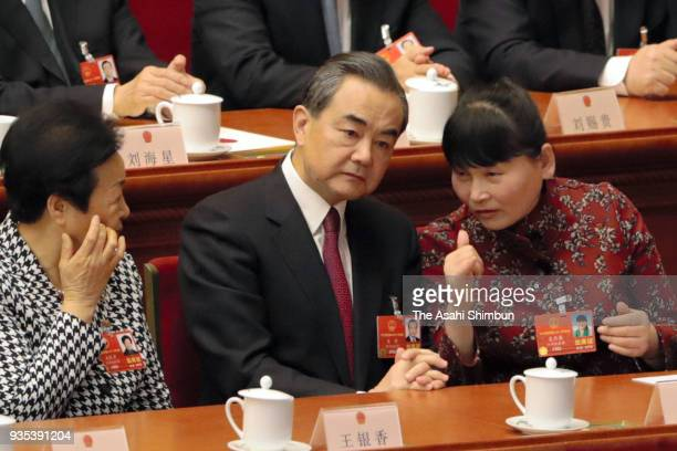 State Councilor Wang Yi attends the seventh plenary session of the 13th National People's Congress at the Great Hall of the People on March 19 2018...