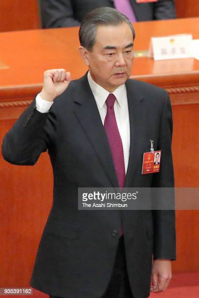 State Councilor Wang Yi swears an oath during the seventh plenary session of the 13th National People's Congress at the Great Hall of the People on...