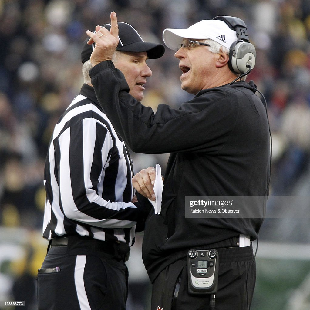 N.C. State defensive coordinator Mike Archer argues with an official during the second half of the Franklin American Mortgage Music City Bowl at LP Field in Nashville, Tennessee, Monday, December 31, 2012. The Vanderbilt Commodores defeated the N.C. State Wolfpack, 38-24.