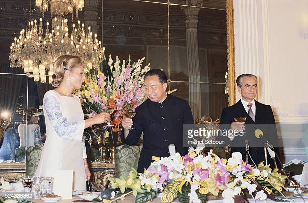 A state dinner is held for Chinese Premier Hua Guofeng at Niavaran Palace in Tehran To the left of him is Farah Diba Empress of Iran and to the right...