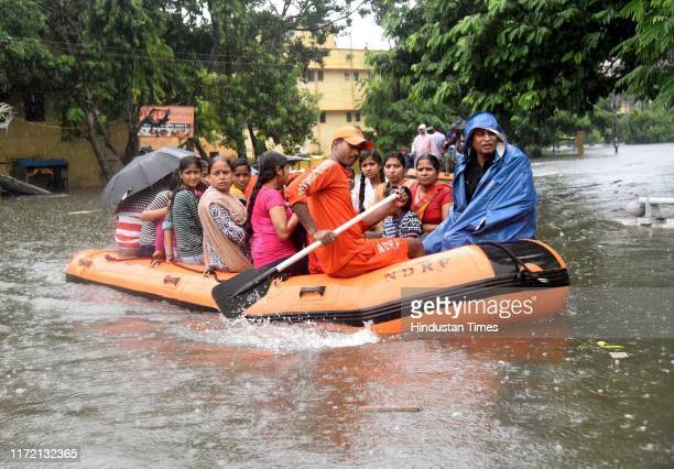 State Disaster Response Force workers rescue people from the flood affected area of Bahadurpur following heavy rainfall on September 29 2019 in Patna...