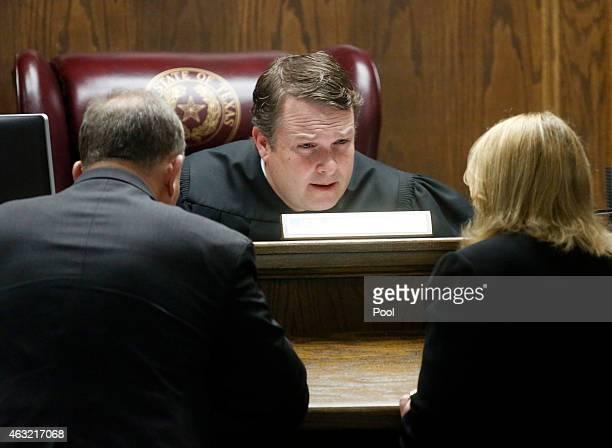 State District Judge Jason Cashon confers with court appointed defense attorney J Warren St John and Erath Assistant District Attorney Jane Starnes...