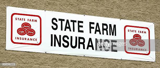 State Farm Insurance signage is seen at an auto claim center August 30 2005 in Palatine Illinois Damage from Hurricane Katrina may destroy previous...