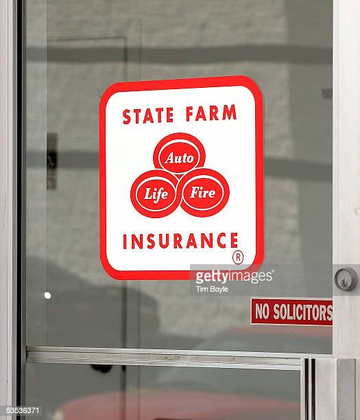 State Farm Insurance signage is seen on a door of an auto claim center August 30 2005 in Palatine Illinois Damage from Hurricane Katrina may destroy...