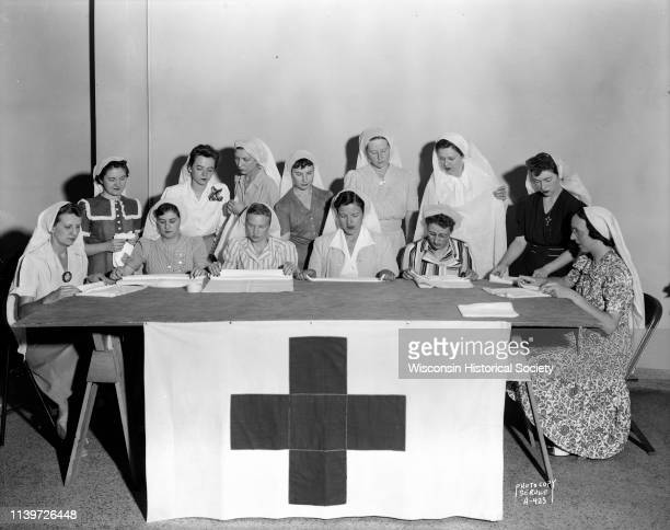 State female employees making surgical dressings / bandages for the American Red Cross in the Wisconsin State Employees Association building 448 W...