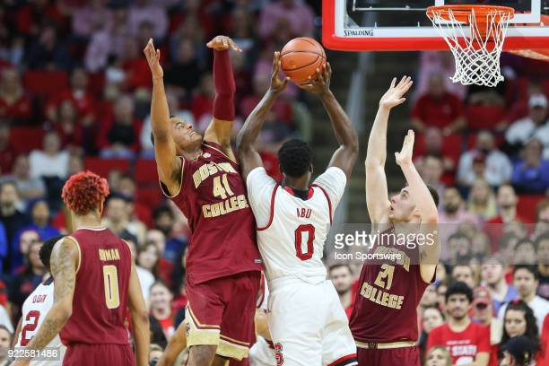 State forward AbdulMalik Abu attempts a shot while defended by Boston College forward Stefan Mitchell and forward Nik Popovic during the game between...