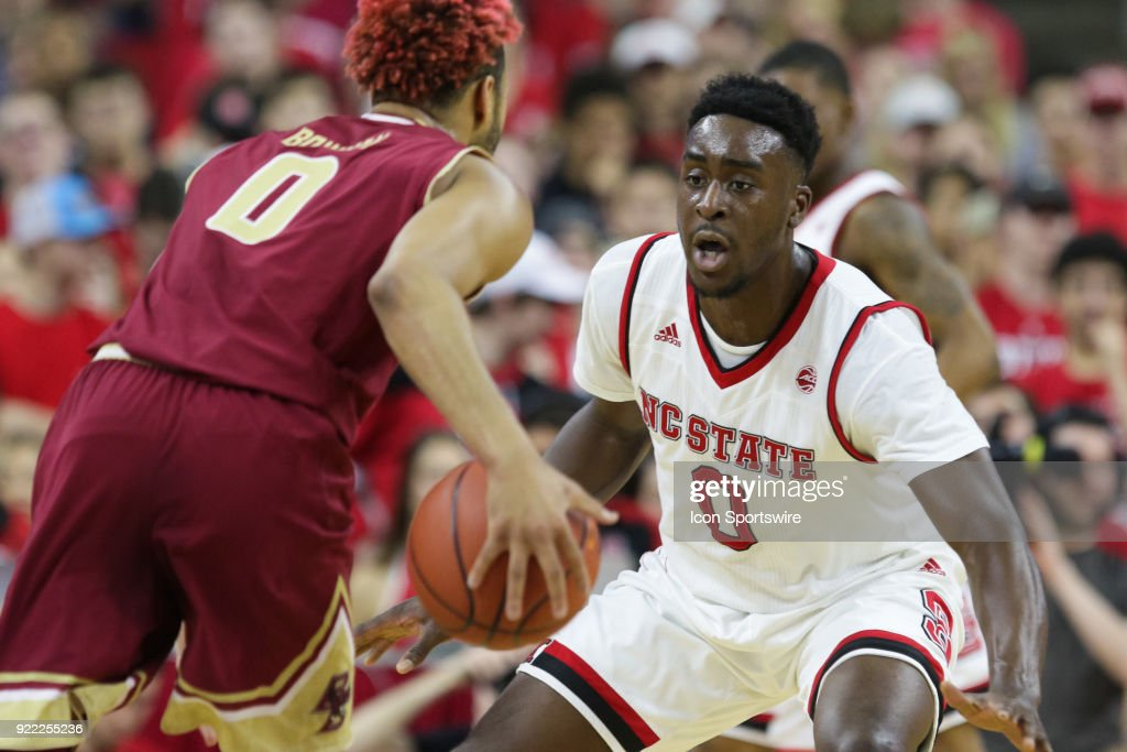 NC State forward Abdul-Malik Abu (0) guards Boston College guard Ky Bowman (0) during the game between the Boston College Eagles and the NC State Wolfpack at PNC Arena on February 20, 2018 in Raleigh, NC. The Pack won 82-66.
