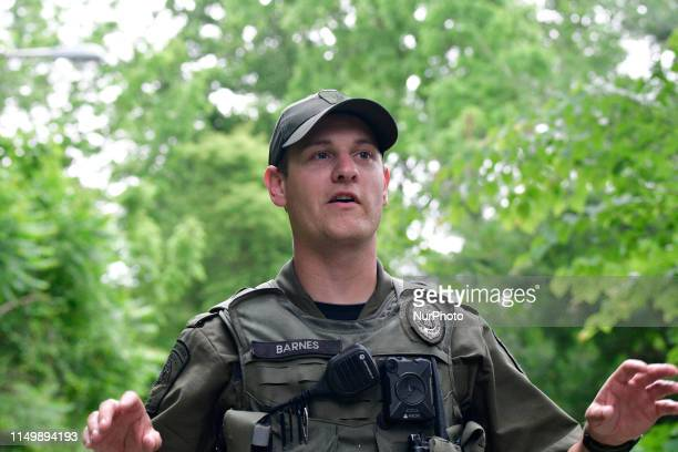PA State Game Commission Warden Tyler Barnes searches a wooded early after multiple residents reported a black bear wondering the Roxborough and...