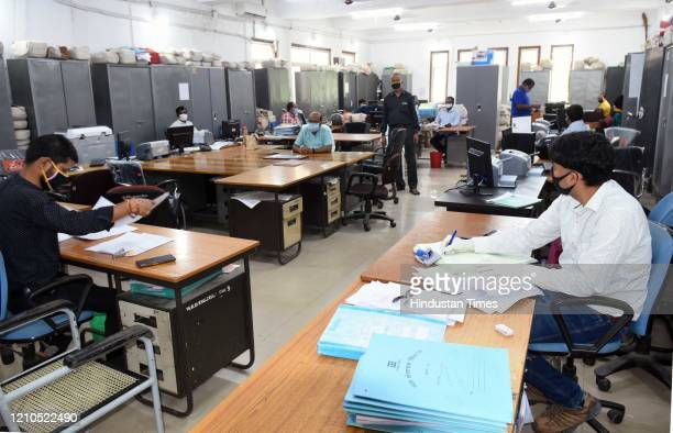 State government employees at work while maintaing social distance at the Nepal House Secretariat, on April 20, 2020 in Ranchi, India.
