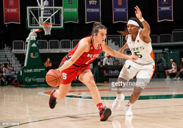State guard Aislinn Konig is guarded by Miami guard Mykea Gray during a women's college basketball game between the NC State University Wolfpack and...
