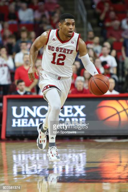 State guard Allerik Freeman brings the ball up the court during the game between the Boston College Eagles and the NC State Wolfpack at PNC Arena on...