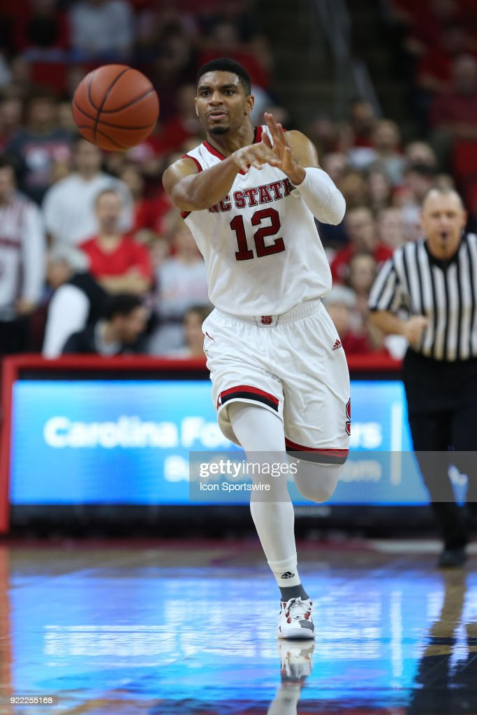 NC State guard Allerik Freeman (12) passes the ball during the game between the Boston College Eagles and the NC State Wolfpack at PNC Arena on February 20, 2018 in Raleigh, NC. The Pack won 82-66.