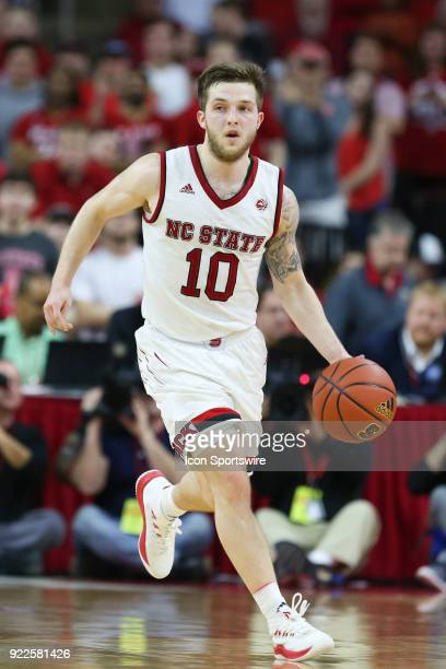 State guard Braxton Beverly brings the ball up the court during the game between the Boston College Eagles and the NC State Wolfpack at PNC Arena on...