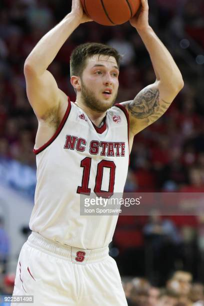 State guard Braxton Beverly looks to pass the ball during the game between the Boston College Eagles and the NC State Wolfpack at PNC Arena on...